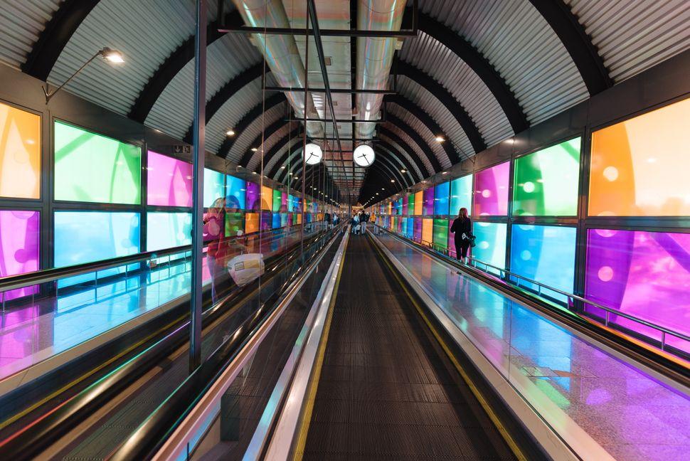 Madrid, Spain - June 20, 2018: Futuristic architecture mechanical corridor in Barajas - Adolfo Suarez Airport