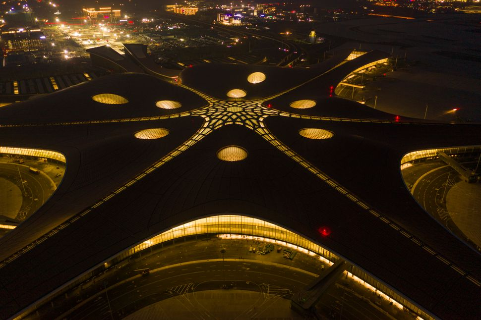 The Beijing Daxing International Airport is illuminated by light projections at night in Beijing, China, 28 June 2019. A lighting test was carried out at night at the new Beijing Daxing International Airport. A project manager said the airport, set to open before the end of September, boasts the world��s most advanced lighting system. (Photo by BJNews - Imaginechina/Sipa USA)