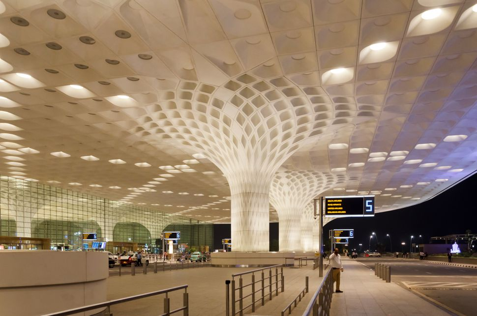 Mumbai, India - January 5, 2015: Travelers visit Chhatrapati Shivaji International Airport. The New Terminal 2, International Departures on January 5, 2015 in Mumbai, India. Skidmore, Owings and Merrill (SOM) was the architectural designer of the project.