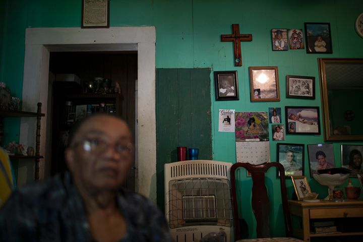 "Lou Alice Bolden with a crucifix and framed photographs in her home in Greenwood, Miss., Saturday, June 8, 2019. Known as ""Mi"