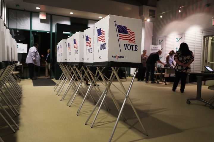 TAMPA, FL - OCTOBER 22:  Voting booths are setup at the Yuengling center on the campus of University of South Florida as work