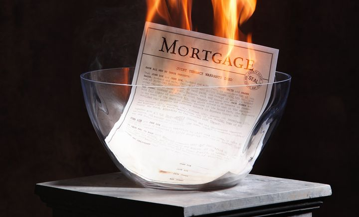 A home mortgage being burnt after the home is paid off