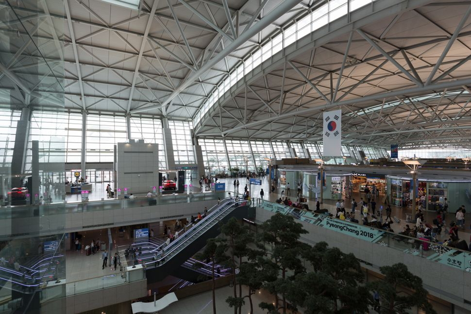 Incheon, Korea - September 11, 2017: People at Incheon International Airport in South Korea. It is the largest airport in South Korea, the primary airport serving the Seoul Capital Area, and one of the largest and busiest airports in the world.
