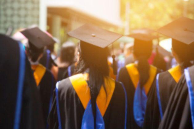 Group of Graduates during commencement. Concept education congratulation in University. Graduation Ceremony...