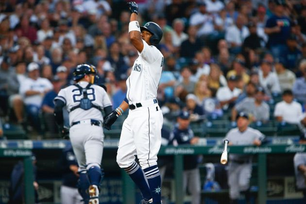 SEATTLE, WA - AUGUST 26: Keon Broxton #4 of the Seattle Mariners throws his bat after striking out to...