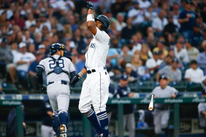 SEATTLE, WA - AUGUST 26:  Keon Broxton #4 of the Seattle Mariners throws his bat after striking out to end the second inning,
