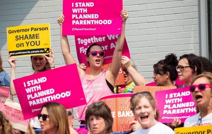 Pro-choice supporters and staff of Planned Parenthood hold a rally outside the Planned Parenthood Reproductive Health Service