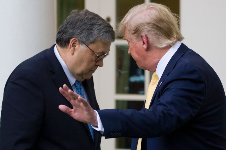 Attorney General William Barr and President Donald Trump turn to leave after speaking in the White House Rose Garden on July