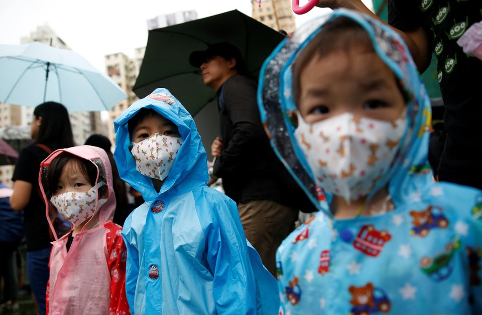 Children are pictured during a protest in Hong Kong, August 25,