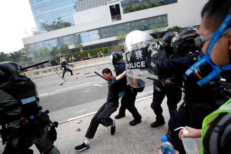 Riot police detain a demonstrator as they clash during a protest in Hong Kong, August 24, 2019.