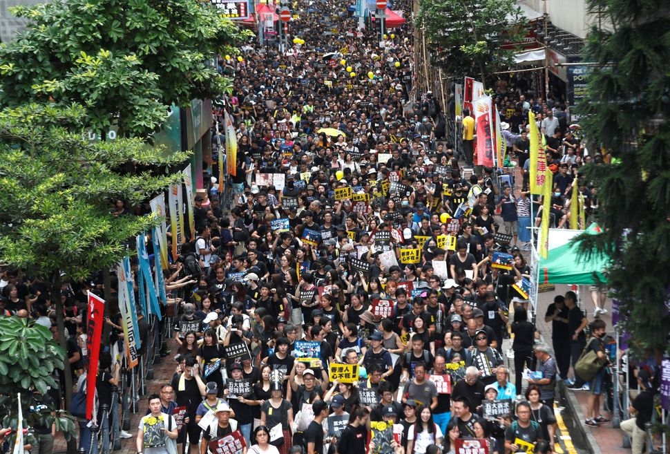 Anti-extradition bill protesters march to demand democracy and political reforms, in Hong Kong, August 18, 2019.