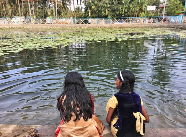 Children play in the water at a newly renovated community pond in Thrikkannapuram, Kerala, India. (Photo...