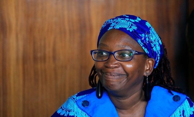 Ugandan prominent academic Stella Nyanzi smiles as she appears at Buganda Road court charged with cybercrimes...