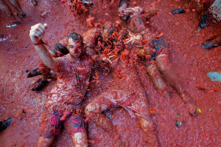 """Revellers throw tomatoes at each other, during the annual """"Tomatina"""" tomato fight fiesta, in the village of Bunol, near Valen"""