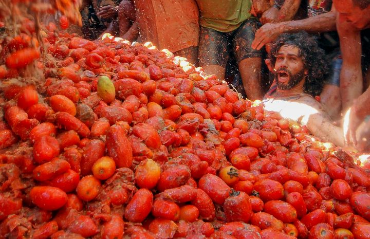 """Revellers party during the annual """"Tomatina"""" tomato fight fiesta, in the village of Bunol, near Valencia, Spain, Spain, Wedne"""