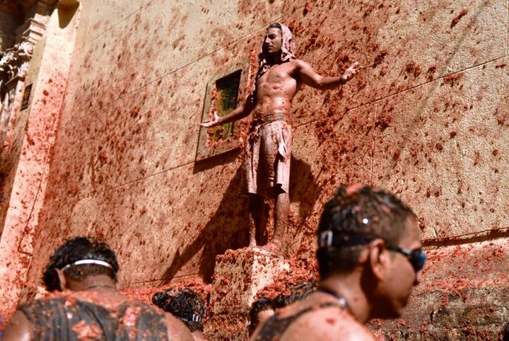 VALENCIA, SPAIN - AUGUST 28: A man with his arms opened is seen participating in the festival of 'La Tomatina' in