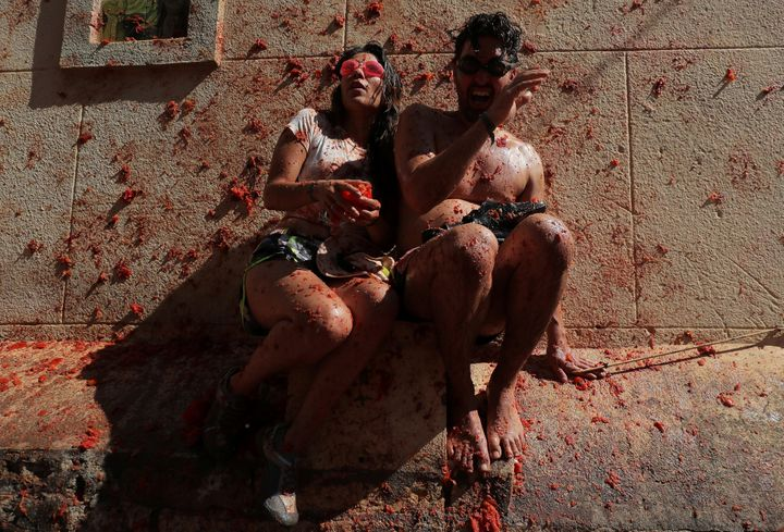 """Revellers react during the annual """"La Tomatina"""" food fight festival in Bunol, near Valencia, Spain, August 28, 2019. REUTERS/"""