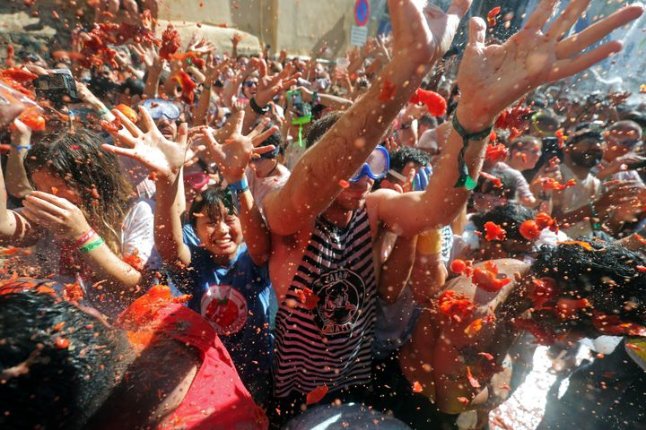 """Revellers throw tomatoes during the annual """"La Tomatina"""" food fight festival in Bunol, near Valencia, Spain, August 28, 2019."""