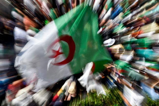 Algerian demonstrators gather in the streets of the capital Algiers against the ruling class amid an...