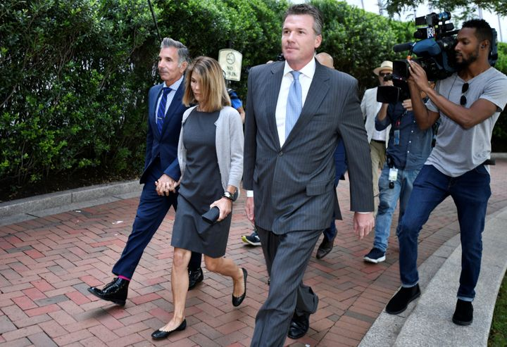 Actress Lori Loughlin and her husband, fashion designer Mossimo Giannulli, arrive at the federal courthouse for a hearing on