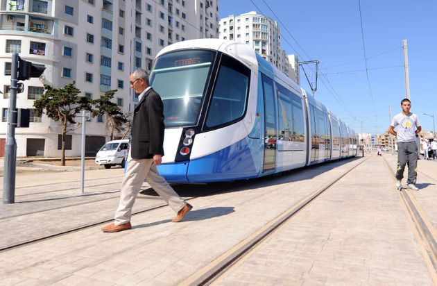 Men walk along the tracks of Algiers new tramway system which opened on May 8, 2011. After a two-year...
