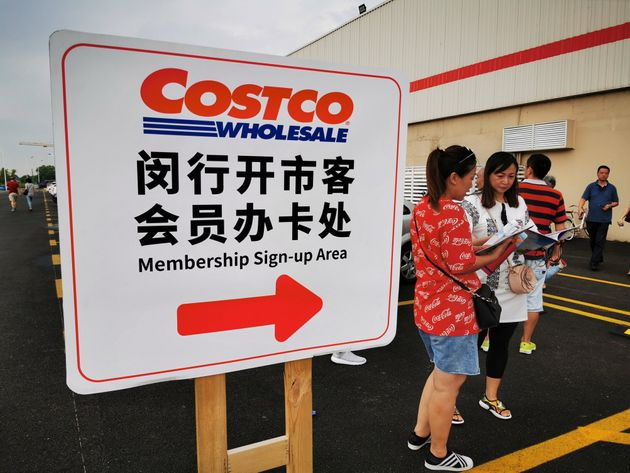 SHANGHAI, CHINA - AUGUST 24: People stand in front of a Costco store on August 24, 2019 in Shanghai,...