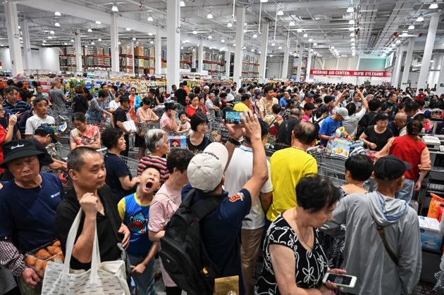 TOPSHOT - People visit the first Costco outlet in China, on the stores opening day in Shanghai on August...
