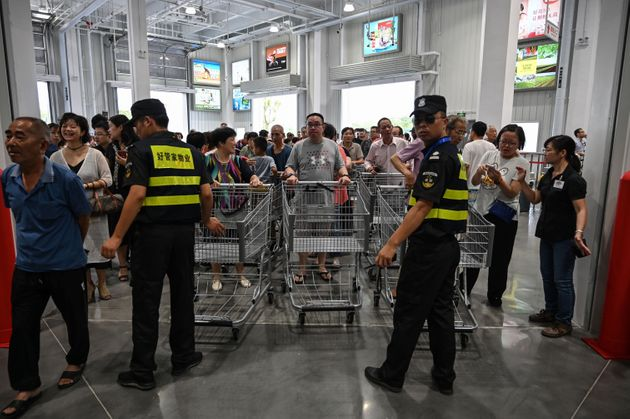 People visit the first Costco outlet in China, on the stores opening day in Shanghai on August 27, 2019....