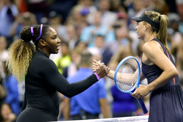 TOPSHOT - Maria Sharapova (R) of Russia shake hands after losing against Serena Williams of the United...