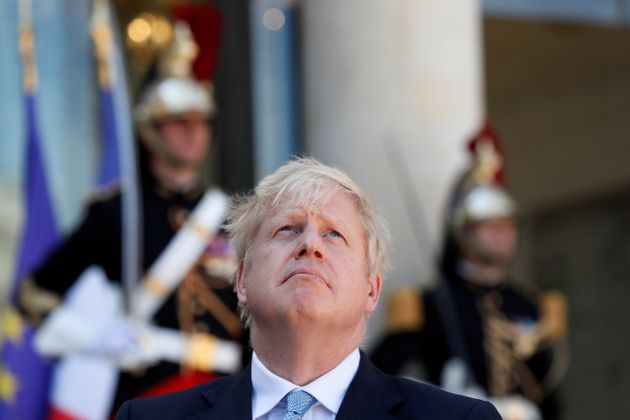 British Prime Minister Boris Johnson reacts during a joint statement with French President Emmanuel Macron...