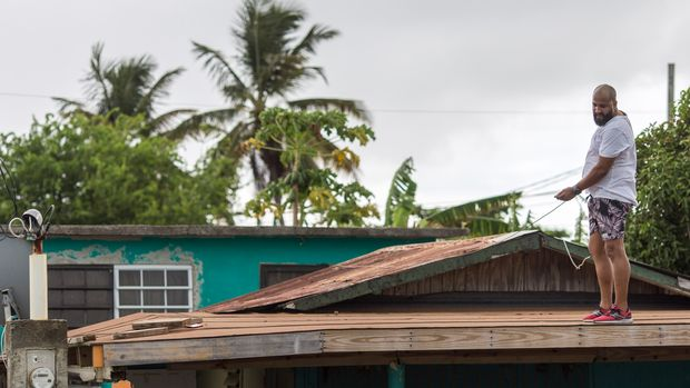 Lemuel Otero, 40 battening down the roof at his property in Materiño, Fajardo. Puerto Rico prepares to receive the hit of Tropical Storm Dorian today August 128, 2019 in Fajardo, Puerto Rico. Tropical Storm Dorian will be the first major storm to hit the Island after the 2017 Hurricane Maria.Photo by Dennis M. Rivera Pichardo for The Huffington Post