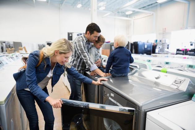 Young family shopping for clothes washer in appliance
