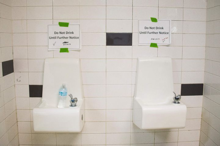 Placards posted above water fountains warn against drinking the water at Flint Northwestern High School in Flint, Michigan, o