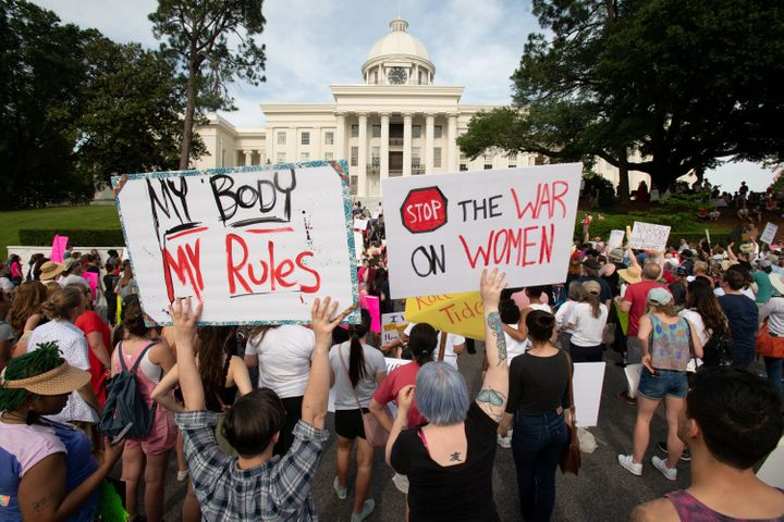 People gather at the Alabama State Capitol during the March for Reproductive Freedom against the state's new abortion law, th
