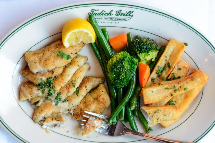 Pan-fried sand dabs with long branch potatoes, vegetables and butter sauce at Tadich Grill.