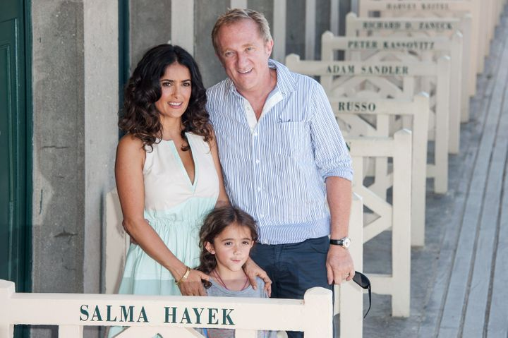 Salma Hayek poses with her daughter, Valentina Paloma Pinault, and her husband, Francois-Henri Pinault, in 2012.