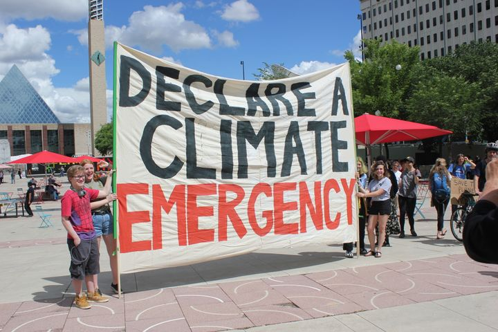 "Student protesters hold up a banner that says ""declare a climate emergency"" during a march in Edmonton on June 28."