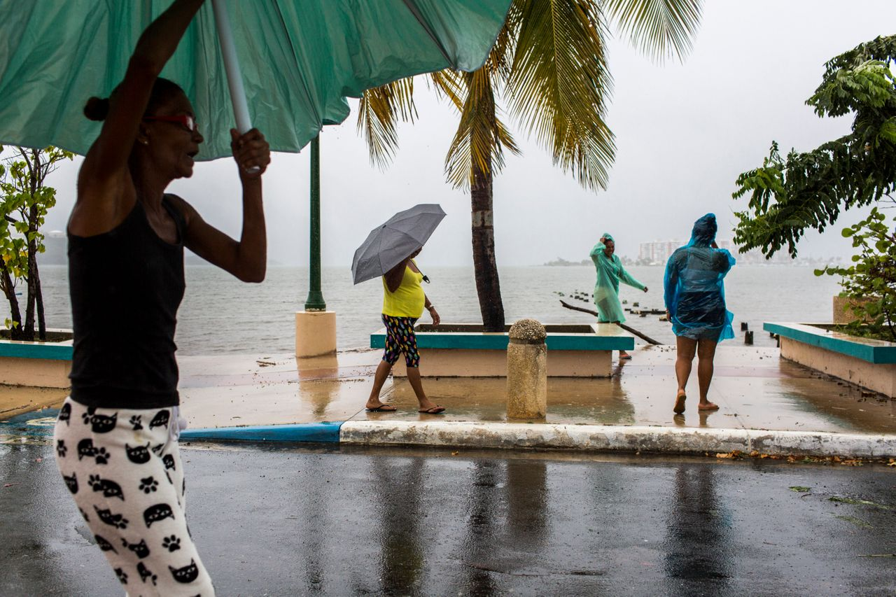 A group of ladies walks along the Fajardo Malecon after the storm passed in Fajardo, Puerto Rico.