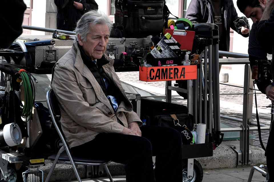 Greek-French film director Costas-Gavras rests during the shooting of the film 'Adults in the room' in...