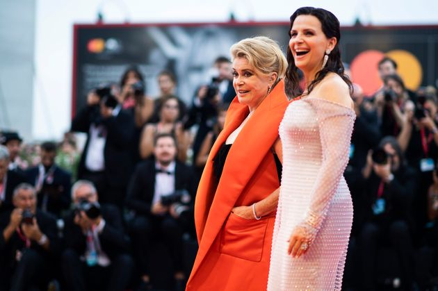 Actresses Catherine Deneuve, left, and Juliette Binoche pose for photographers upon arrival at the premiere...