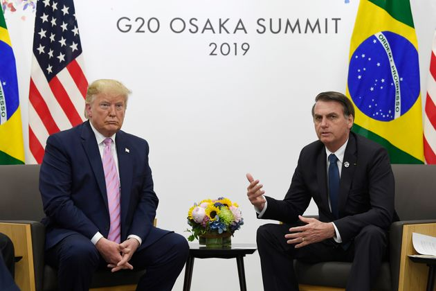 President Donald Trump, left, meets with Brazilian President Jair Bolsonaro, left, during a bilateral...