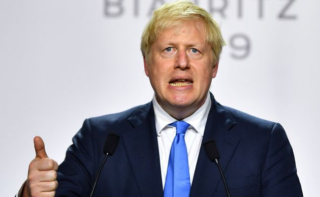 Britain's Prime Minister Boris Johnson speaks during a news conference at the end of the G7 summit in...