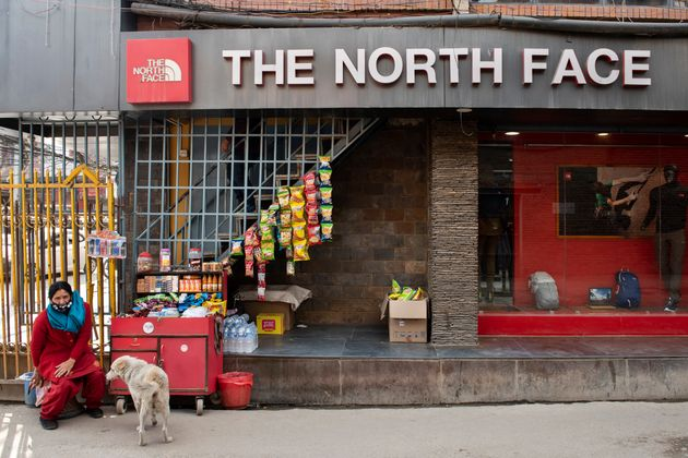 KATHMANDU, NEPAL - 2019/03/05: A snack stand is seen next to an American outdoor clothing brand The North...