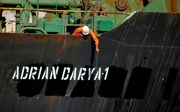 A crew member takes pictures with a mobile phone on Iranian oil tanker Adrian Darya 1, previously named...