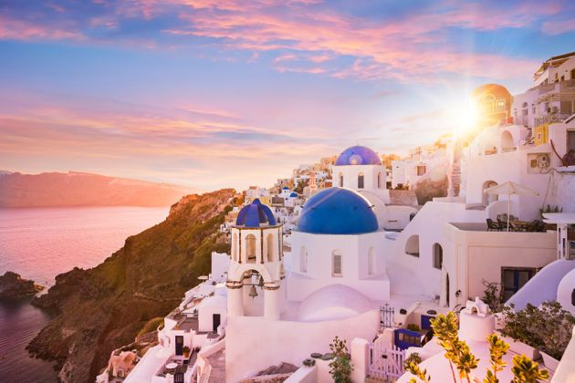Sunset view of the blue dome churches of Santorini, Greece,