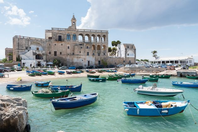 San Vito port with old abbaye in the background dating 16th century abbey. Polignano a Mare, Bari province,...