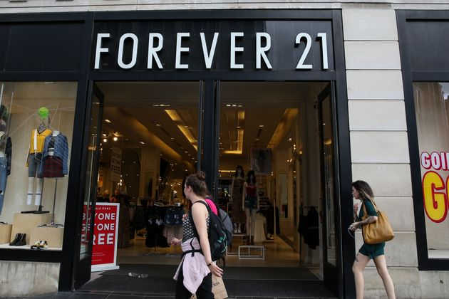 LONDON, UNITED KINGDOM - 2019/08/09: Shoppers walk past a branch of Forever 21 store in central London....