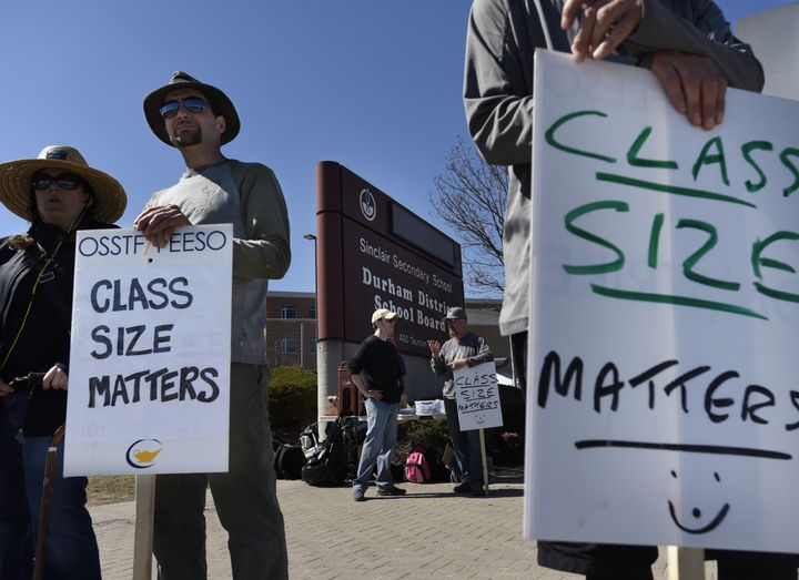 Teachers walk the picket line outside Sinclair Secondary School in Whitby, Ont. on April 28, 2015.