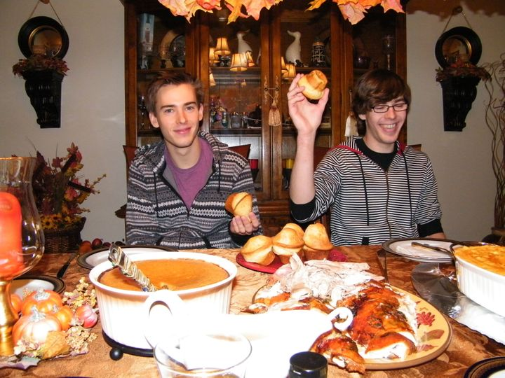 Andrew (left) and Mathew (right) sharing a laugh at Thanksgiving dinner in 2013.