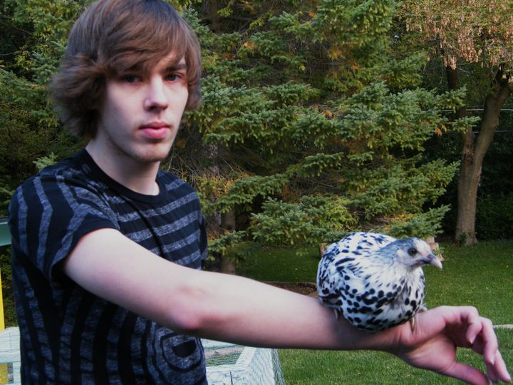Matt holding his chicken, named Sir Guinevere, in 2009.